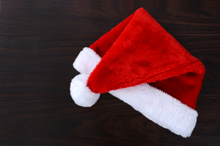 Santa hat laying on a table top Christmas concept