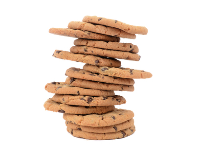 homemade chocolate chip cookies stacked isolated white background