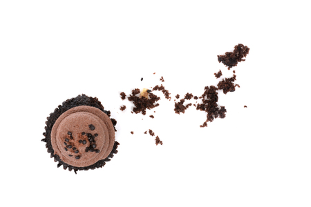 chocolate cupcake with crumbs isolated on white background food concept Zdjęcie Seryjne