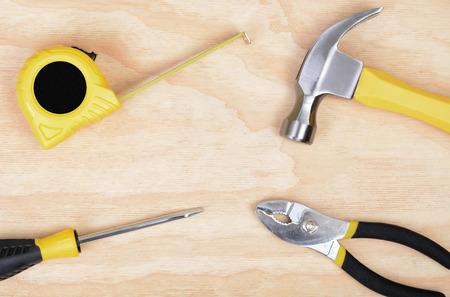 set of tools on wood background hammer, screwdriver,tape measure,pliers, Zdjęcie Seryjne