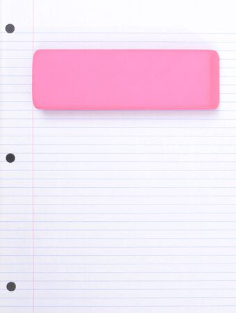 pink eraser on lined notebook paper school concept