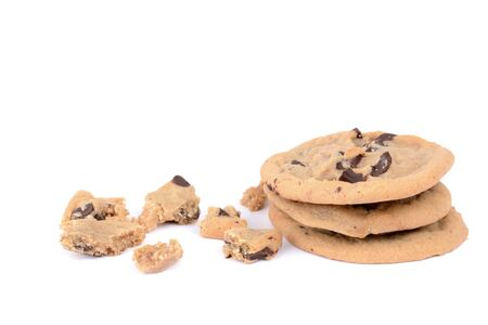 chocolate chip cookies in a pile with crumbs food isolated white background