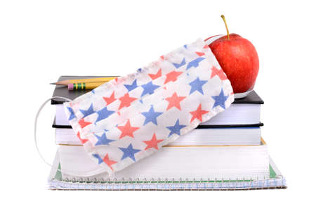 school supplies books apple and covid 19 mask for coronavirus isolated white background Zdjęcie Seryjne