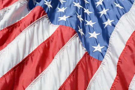 american flag blowing in the wind close up Zdjęcie Seryjne