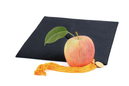 apple and graduation cap with gold tassel isolated white background education concept Zdjęcie Seryjne