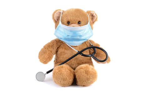 stuffed bear with mask and stethoscope isolated white background medical concept Zdjęcie Seryjne