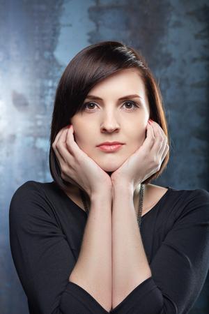 brown  eyed: Beautiful woman. Professional make up. Black dress, red manicure