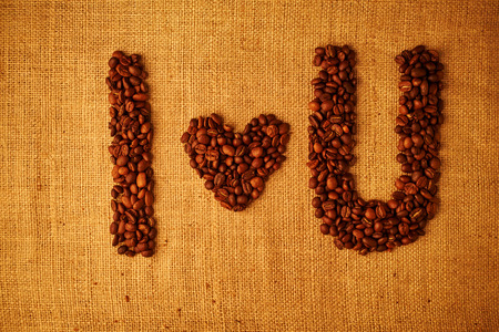 coffe bean: coffe bean I love you on sacking background Stock Photo