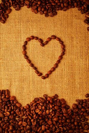 sacking: coffee bean heart on sacking background Stock Photo