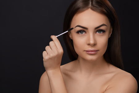 Mascara. Beauty Makeup, Fresh Soft Skin And Long Black Thick Eyelashes Applying Mascara With Cosmetic Brush. Eyelashes extensions. Fake Eyelashes. Stock Photo