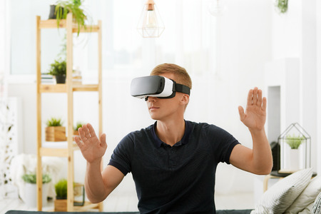 Smartphone using with VR glasses. Man wearing virtual reality glasses. Virtual reality today.