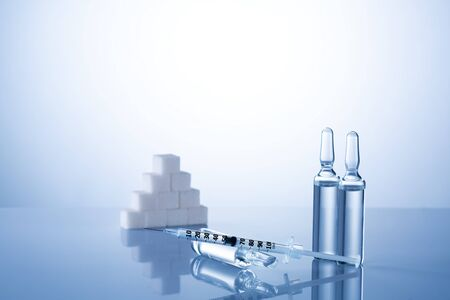 Diabetes,insulin,high blood sugar,hyperglycemia. Ampoules vials, syringe. Medical injection,diseases,health care. Medical background with copy space Diabetes World Day