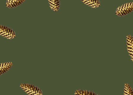 Pattern made from golden pine cone frame arrangement on green trendy color 2020 backdrop. Flat lay, top view, christmas background wallpaper. Reklamní fotografie