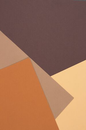 Abstract geometric paper background in earth tone. Many earth tones originate from clay earth pigments, such as umber, ochre, and sienna. Color papers geometry composition.