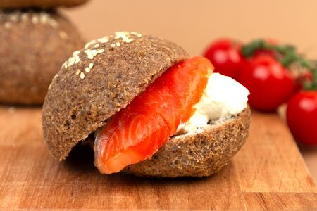 Keto bread made from almond flour and psyllium with cream cheese and a slice of salmon. Paleo and intermittent fasting diet. 版權商用圖片