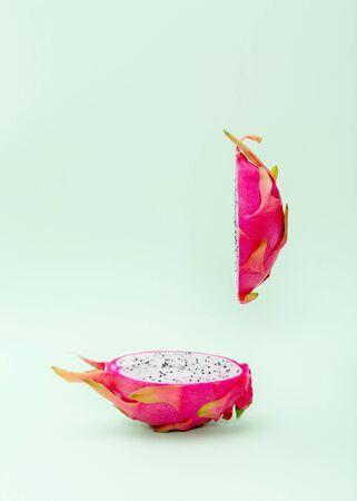 Flying in air fresh ripe dragon fruit or pitaya. Food levitation concept.
