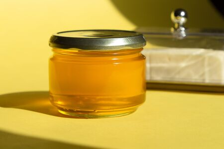 Ghee or clarified butter in jar. Healthy eating and using organic fresh made products. Healthy ingredient for cooking organic meal.
