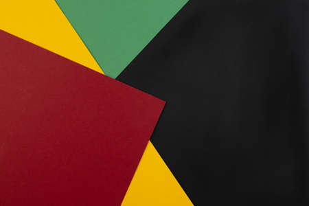 February Black History Month. Abstract Paper geometric black, red, yellow, green background. Copy space, place for your text. Top view. Foto de archivo