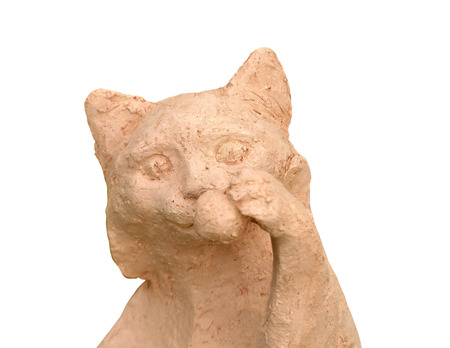 Portrait of a cat crocheted from clay on an isolated background. Imagens