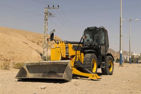 dozer: Yellow tractor - dozer - pitchfork Stock Photo
