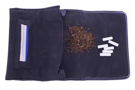 pouch: Open tobacco pouch with cigarette paper, tobacco and filters Stock Photo