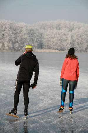 Boy using his mobile phone while skating together with his girlfriend Stock Photo - 2643472