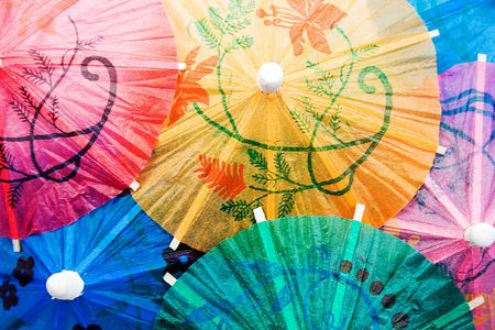 Cocktail umbrellas composed in close-up photo