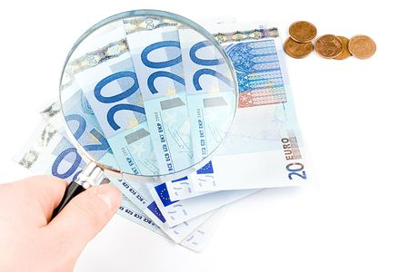 kept: Isolated euro money under the reading glass kept in hand