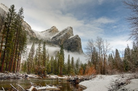 Winter in Yosemite National Park is a special time. This is a picture of Eagle Peak, Middle Brother and Lower Brother with the Merced River in the foreground. Stock Photo - 7633406