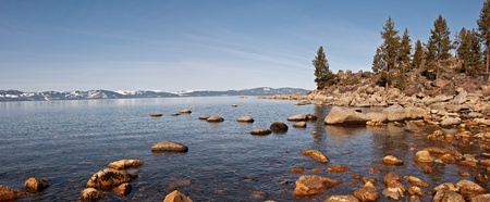 A panoramic view of the California side of Lake Tahoe from the rocky Nevada shoreline. Stock Photo - 8552782