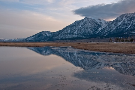 A reflection of Jobs Peak at sunset from Carson Valley, Nevada.  Stock Photo