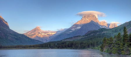 A view of Mount Wilbur and Swiftcurrent Mountain above Swiftcurrent Lake in Many Glacier, Glacier National Park, Montana. Stock Photo - 8552780
