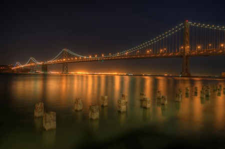 A night view of the San Francisco Bay Bridge and Oakland from San Francisco.