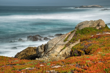 A view of the Pacific Coastline and  Bird Rock on the 17 Mile Drive in Monterey, California. Stock Photo