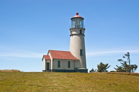 The lighthouse at Cape Blanco State Park on a clear summer day. Stock Photo
