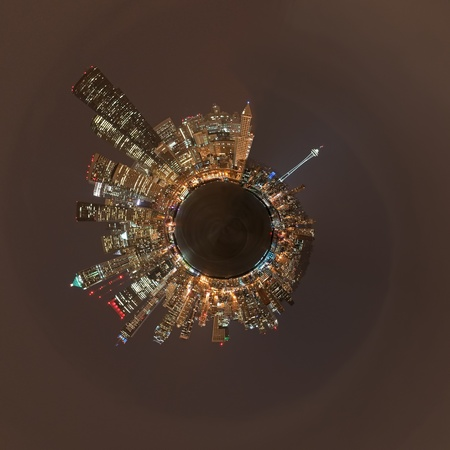 A planetoid of a night panorama of the skyline in Seattle, Washington. Stock Photo