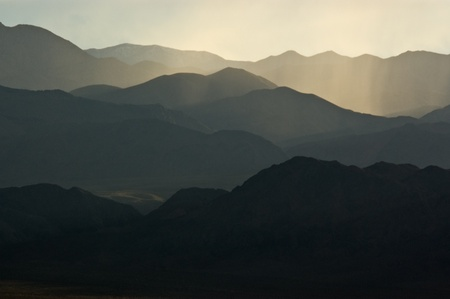 A backlit mountainscape in the desert of Death Valley Natoinal Park, California. Stock Photo - 8914528