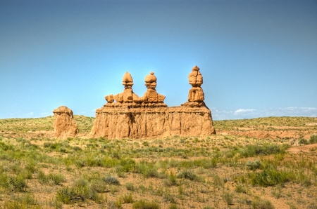 goblins: Three goblins bake in the warm sun in Goblin State Park, Utah.