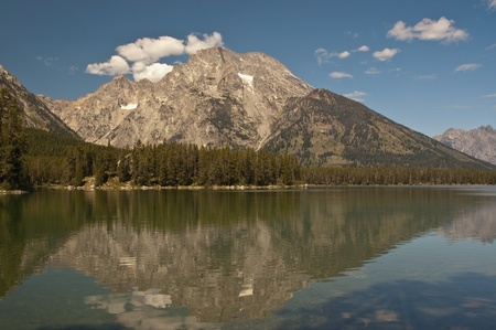 Mount Moran reflecting on Leigh Lake in Grand Tetons National Park, Wyoming. photo