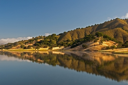 chaparral: A morning reflection on Uvas Reservoir of the rolling hills and chaparral of the central California. Stock Photo