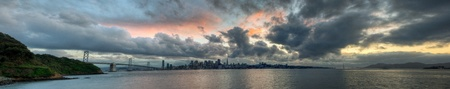 A panoramic skyline of San Francisco with a colorful sunset.