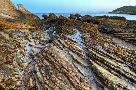 The layered rocks in Spooners Cove in Montana De Oro State Park.