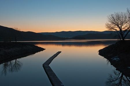 topaz: A sunrise reflection on Topaz Lake, Nevada.