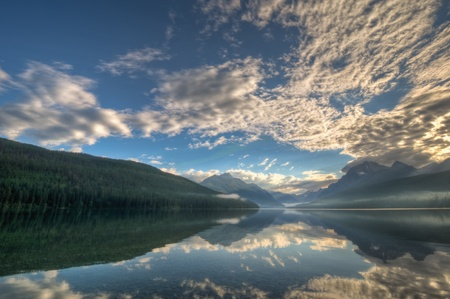 A sunrise reflection on Lake Bowman in Glacier National Park, Montana.