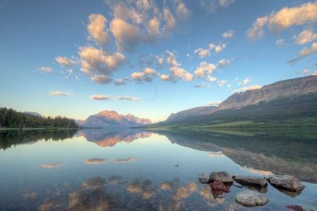 A sunrise reflection on Saint Mary Lake in Glacier National Park, Montana. Stock Photo
