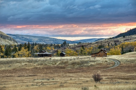 A colorful sunrise over the fall colors along the West Boulder River valley, Montana. photo