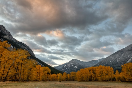 A colorful sunrise over the fall colors along the Boulder River valley, Montana. photo