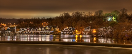 A panorama of the scenic boathouse row at night on the Schuykill River in Philadelphia, Pennsylvania.