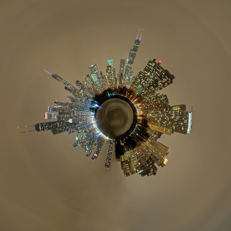 A planetoid of the downtown Chicago skyline at night. Imagens