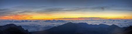 A colorful sunrise viewed from the summit of Haleakala on Maui, Hawaii. Stock Photo